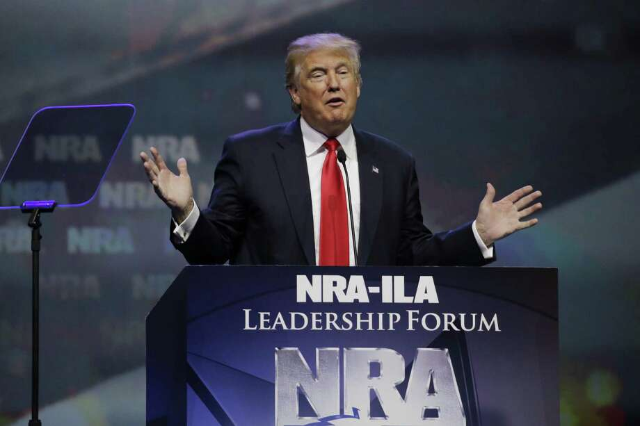 Then-Republican presidential candidate Donald Trump speaks at the National Rifle Association convention in Louisville, Ky., earlier this year. With a supportive Congress and president, the NRA could push for reciprocity laws that would make looser gun restrictions consistent across all 50 states. Photo: Mark Humphrey / Associated Press / Copyright 2016 The Associated Press. All rights reserved.