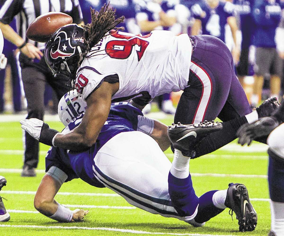 Jadeveon Clowney (90) gives Colts QB Andrew Luck separation anxiety, forcing a third-and-goal fumble recovered by the Texans.