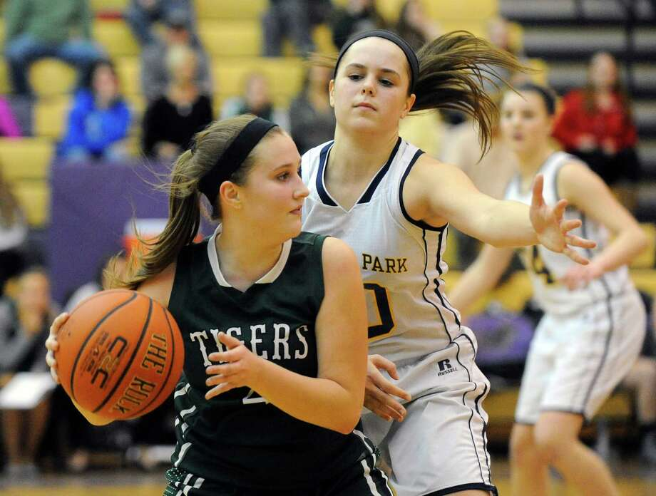 Hudson Falls' Bri McKinney ,left, moves the ball against Averill Park's Stephanie Jankovic ,right, during the second half of a Section II Class A girls' semifinal basketball game in Ballston Spa, N.Y., Tuesday, Feb. 23, 2016. (Hans Pennink / Special to the Times Union) ORG XMIT: HP125 Photo: Hans Pennink / Hans Pennink