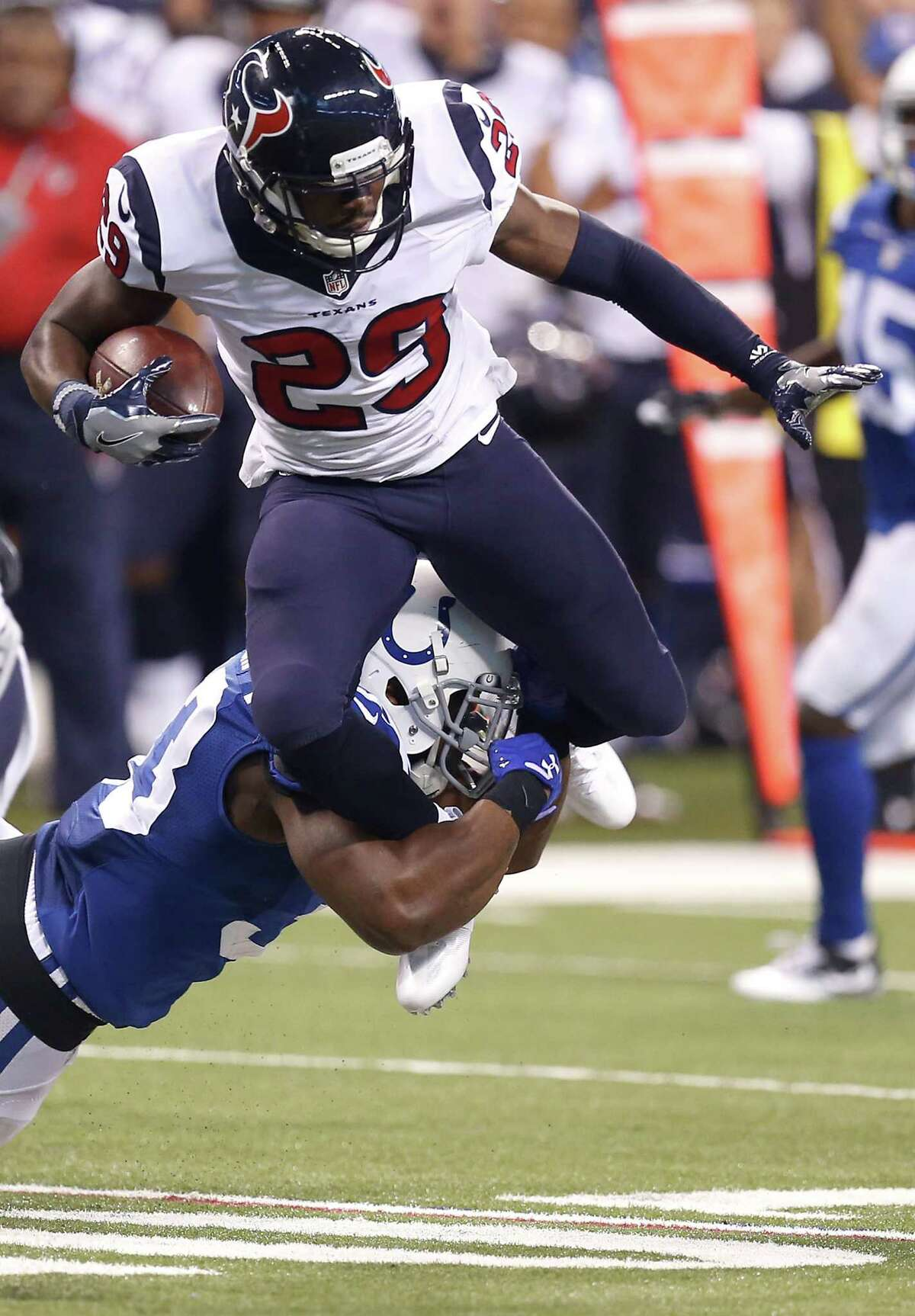Houston Texans free safety Andre Hal (29) is tackled by Indianapolis Colts running back Robert Turbin (33) after Hal intercepted an Andrew Luck pass during the third quarter of an NFL football game at Lucas Oil Stadium on Sunday, Dec. 11, 2016, in Indianapolis. ( Brett Coomer / Houston Chronicle )