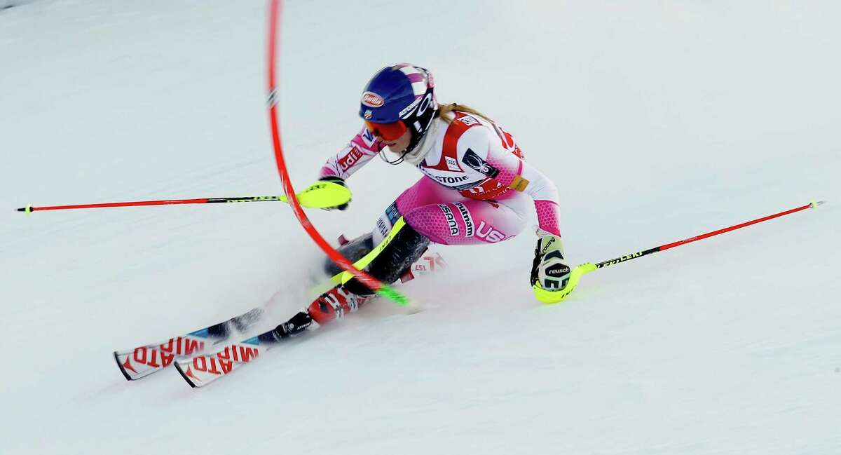 Mikaela Shiffrin of the United States shows her winning technique as she attacks a gate en route to capturing her 11th consecutive World Cup slalom race Sunday at Sestriere, Italy.