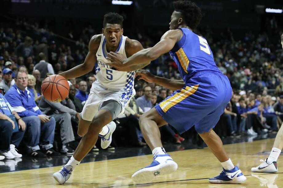 NEW YORK, NY - DECEMBER 11:  Malik Monk #5 of the Kentucky Wildcats drives to the basket against the Eli Pemberton #5 of the Hofstra Pride in the first half of the Brooklyn Hoops Winter Festival at Barclays Center on December 11, 2016 in the Brooklyn borough of New York City.  (Photo by Michael Reaves/Getty Images) ORG XMIT: 677124813 Photo: Michael Reaves / 2016 Getty Images