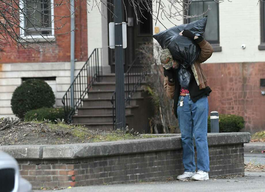 A man on his cell phone gets up from sitting on the low wall on South Ferry Street in the Historic Pastures neighborhood on Tuesday, Dec. 6, 2016 in Albany, N.Y. Residents in the neighborhood are voicing concerns about criminal and suspicious activity going on in this area. (Lori Van Buren / Times Union) Photo: Lori Van Buren / 20039071A