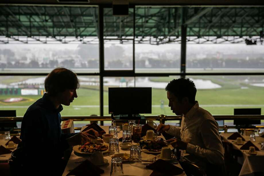 Doctor David Seftel (left), who is the doctor for jockeys at Golden Gate Fields has lunch with colleague Peter Robinson (right), in Berkeley, California, on Thursday, Dec. 8, 2016. Photo: Gabrielle Lurie, The Chronicle