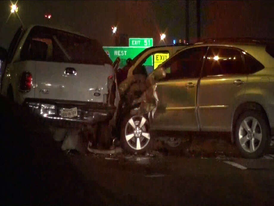A multi-vehicle collision occurred on Loop 610 in Houston, Texas on Dec. 11, 2016. Police say a wrong-way driver crashed into two vehicles, injuring a father and his 10-year-old son in the process. Both are expected to survive. Photo: Metro Video Services, LLC/For The Houston Chronicle