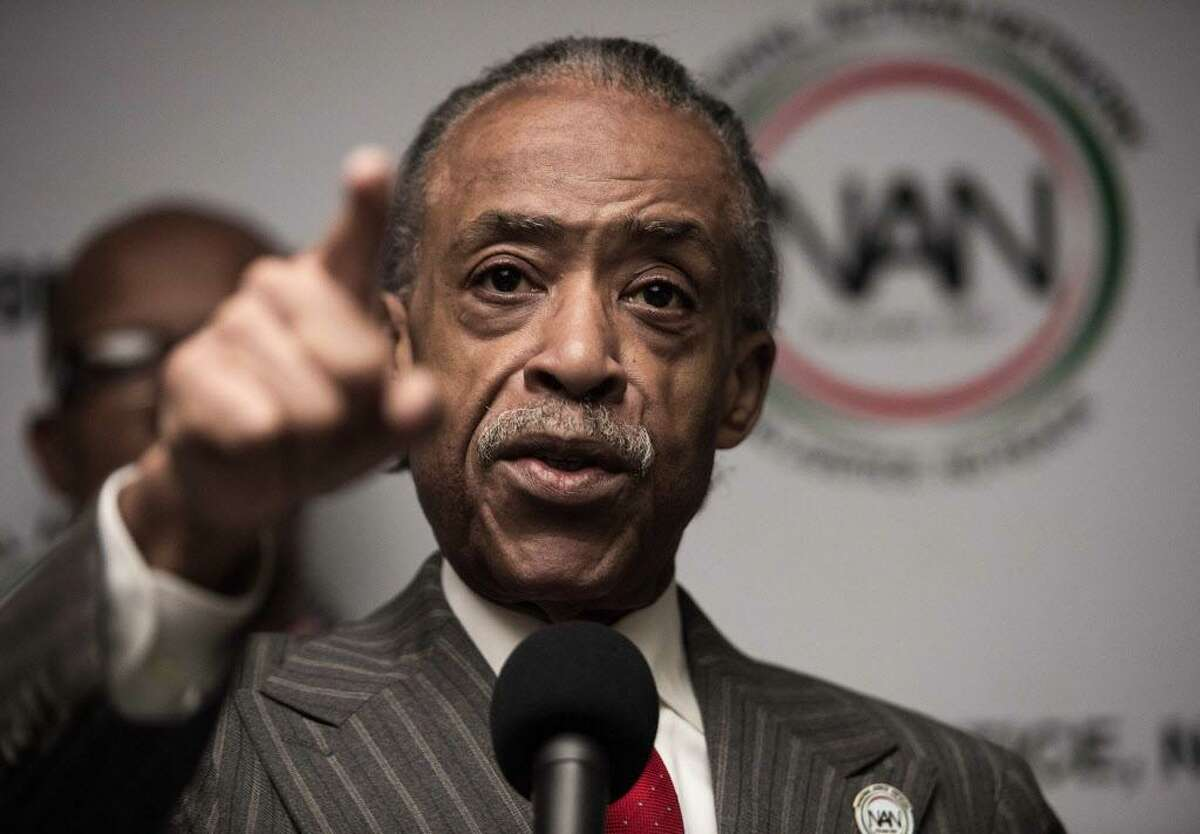 """Rev. Al Sharpton speaks at a press conference at the National Press Club in Washington, DC, on December 5, 2016. Sharpton announced that the """"We Shall Not Be Moved"""" march in Washington will be held on January 14, 2017 commemorating Martin Luther King Jr. and """"to give notice that a collective body of Americans are dedicated and fully committed to moving the legacy and mission Dr. King forward."""""""