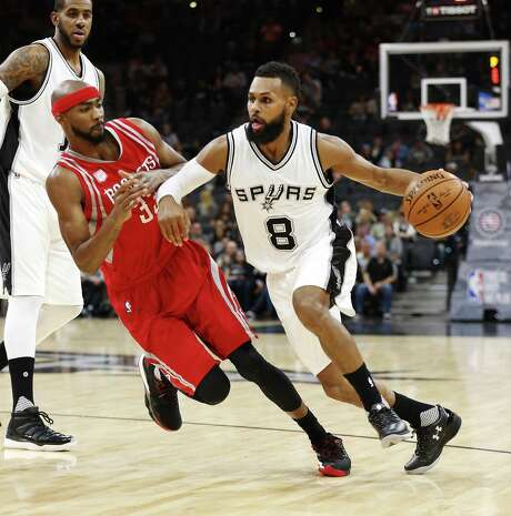 Spurs' Patty Mills drives around the Rockets' Corey Brewer on  Nov. 9 at the AT&T Center. Photo: Kin Man Hui /San Antonio Express-News / ©2016 San Antonio Express-News
