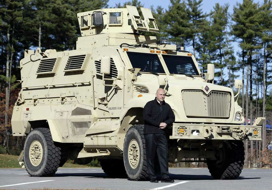 HFM DEC 8 MID DAY **In this Wednesday, Nov. 13, 2013 photo, Warren County Undersheriff Shawn Lamouree poses in front the department's mine resistant ambush protected vehicle, or MRAP, in Queensbury, N.Y. The hulking vehicles, built for about $500,000 each at the height of the war, are among the biggest pieces of equipment that the Defense Department is giving to law enforcement agencies under a national military surplus program. (AP Photo/Mike Groll) Photo: Mike Groll, STF / Associated Press / Copyright 2016 The Associated Press. All rights reserved.