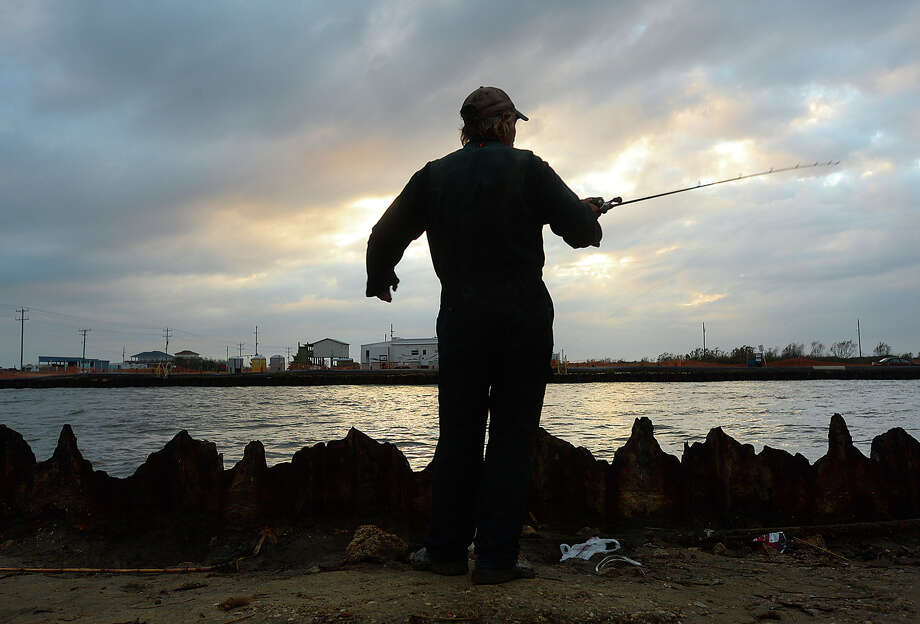 "Rick Waynick, or ""Rollover Rick"" as he is known among the regulars who fish at Rollover Pass in the Bolivar Peninsula, gets in some late day fishing before sundown in January 2016. Waynick has been fishing at the popular waterway between the Gulf and East Bay for 30 years and has a number of reasons why he believes the pass should remain open.SLIDESHOW: Historic photos of Galveston Photo: Kim Brent / Beaumont Enterprise"