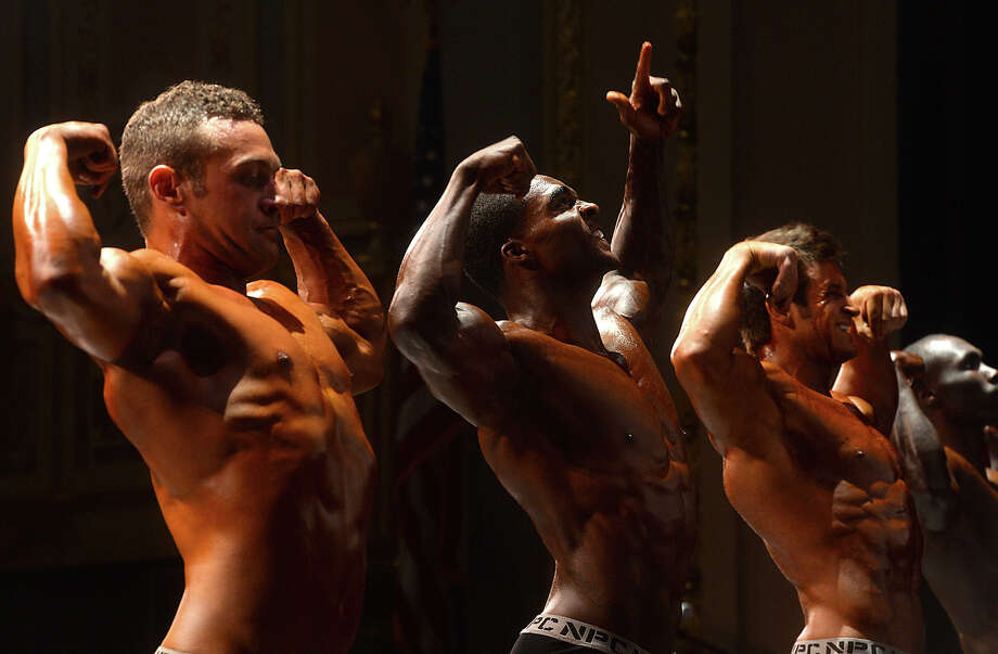 Men pose onstage during the morning portion of Saturday's Southeast Texas Championship at the Julie Rogers Theatre. The National Physique Committee's event is the first body building, fitness and physique competition to hit Beaumont since 1996. Photo taken Saturday, April 23, 2016 Kim Brent/The Enterprise Photo: Kim Brent / Beaumont Enterprise