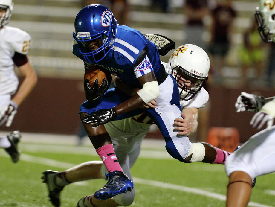 """The advance of West Brook's Cameron McKinney, No. 7, is halted by Deer Park's Seth Brown, No. 19, during Thursday's game. The West Brook Bruins hosted Deer Park at the Carrol A. """"Butch"""" Thomas Stadium on Thursday night. Photo taken Thursday 10/9/14 Jake Daniels/@JakeD_in_SETX Photo: Jake Daniels / ©2014 The Beaumont Enterprise/Jake Daniels"""