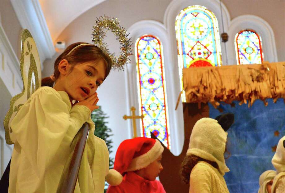 Chloe Culver, 6, of Norwalk, was an angle in St. Michael's Lutheran Church's annual Christmas pageant, Sunday, Dec. 11, 2016, in New Canaan, Conn. Photo: Jarret Liotta / For Hearst Connecticut Media / New Canaan News Freelance
