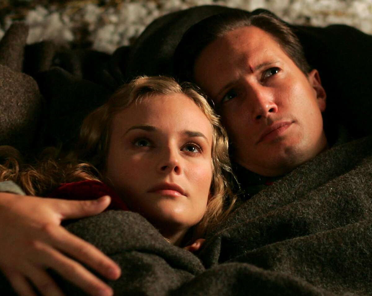 """Actress Diane Kruger (L) and actor Benno Furmann are shown in a scene from the French film """"Joyeux Noel"""" in an undated publicity photo. The film received a nomination for best foreign language film for the upcoming 78th Academy Awards. The nominations were announced in Beverly Hills, California January 31, 2006 and the Oscars will be presented March 5, 2006. NO SALES NO ARCHIVES REUTERS/J.C. Luther/Nord-Ouest Productions/handout"""
