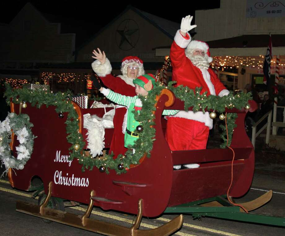 Santa Claus, Mrs. Claus and an elf wave to the crowd during the 34th annual Christmas on the Square parade in Coldspring held on Dec. 10. Photo: Jacob McAdams