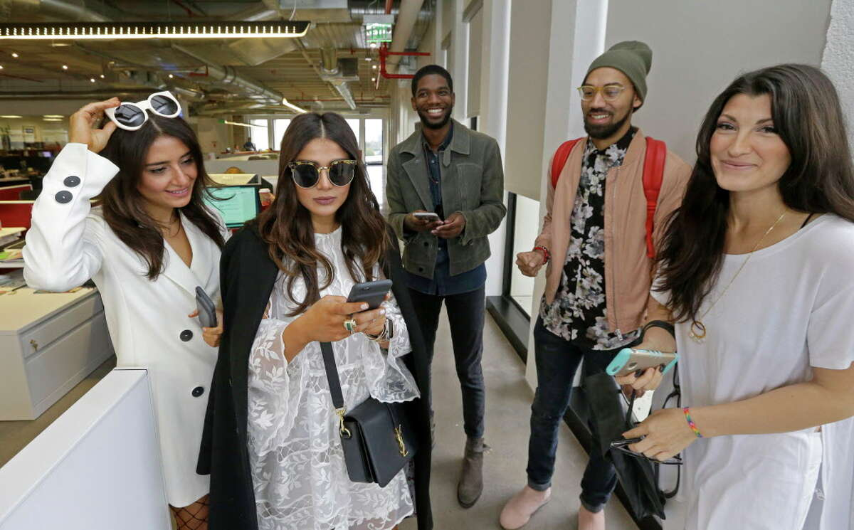 Bloggers Saba Jawda, left, Sarah Jawda, Dominique McGee, Josh Robertson, and Magen Pastor, right, prepare to give a brief runway style fashion show at the Houston Chronicle Monday, Dec. 12, 2016 as a preview for Houston's Day For Night festival.