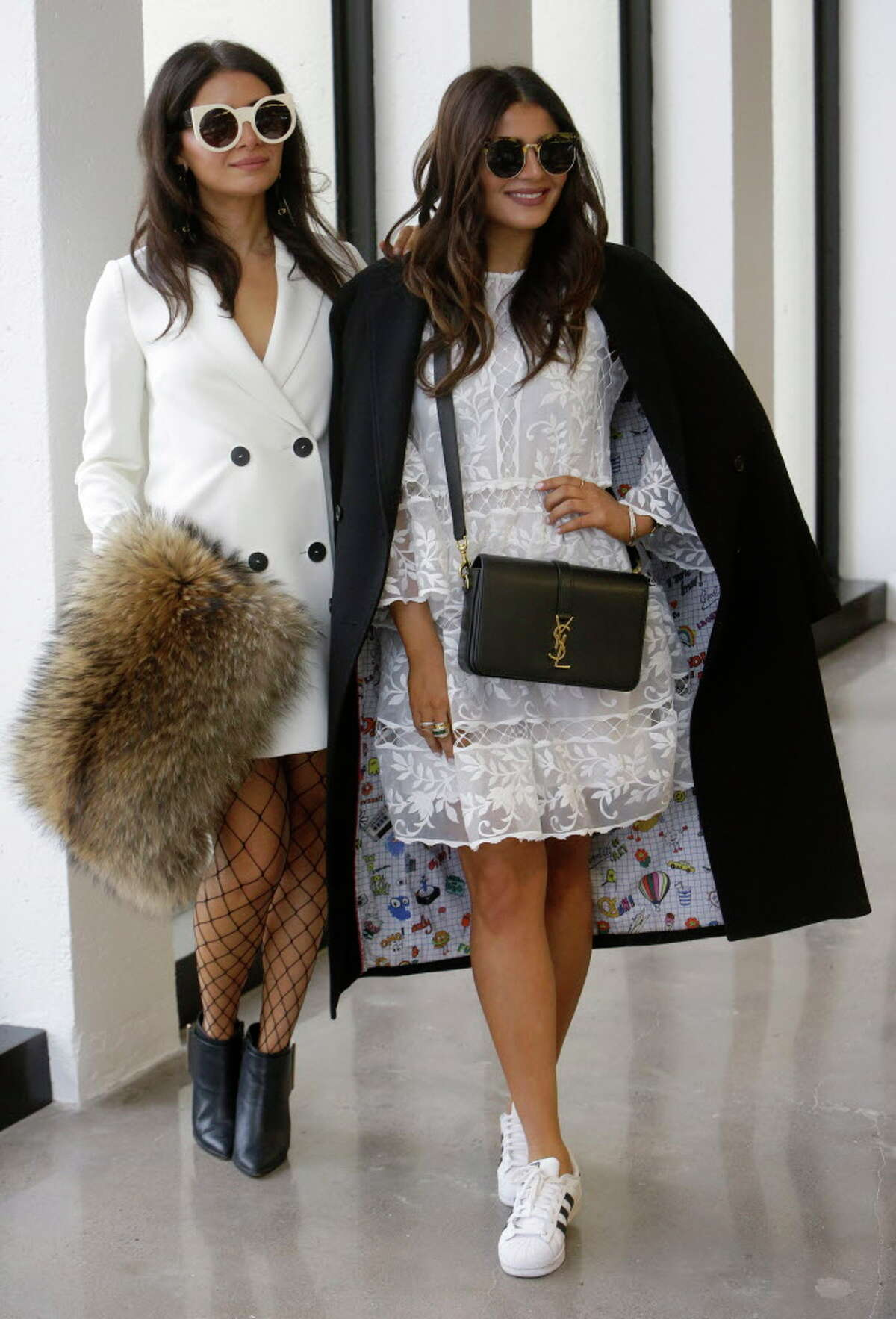 Bloggers Saba Jawda, left, and Sarah Jawda, right, give a brief runway style fashion show at the Houston Chronicle Monday, Dec. 12, 2016 as a preview for Houston's Day For Night festival.