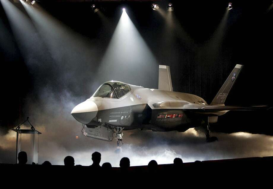 "FILE - In this July 7, 2006, file photo, the Lockheed Martin F-35 Joint Strike Fighter is shown after it was unveiled in a ceremony in Fort Worth, Texas. Shares of Lockheed Martin fell Monday, Dec. 12, 2016, as President-elect Donald Trump tweeted that making F-35 fighter planes is too costly and that he will cut ""billions"" in costs for military purchases. (AP Photo/LM Otero, File) Photo: Matthew Otero, Associated Press"