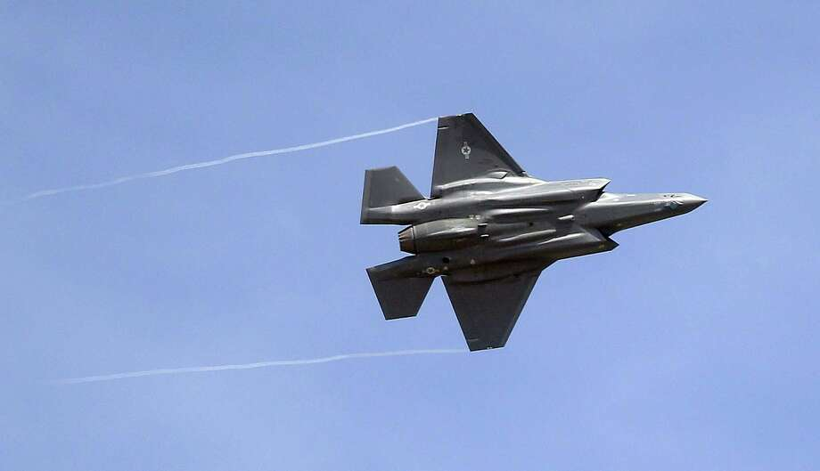 """In this 2015 file photo, an F-35 jet arrives at its new operational base at Hill Air Force Base, in northern Utah. Shares of Lockheed Martin fell Monday, Dec. 12, 2016, as President-elect Donald Trump tweeted that making F-35 fighter planes is too costly and that he will cut """"billions"""" in costs for military purchases. Photo: Rick Bowmer /Associated Press / Copyright 2016 The Associated Press. All rights reserved."""