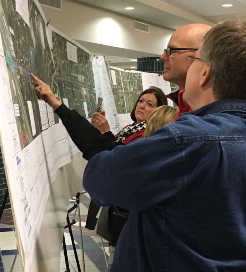 People view maps and diagrams of proposed widening of FM 1463 prior to a Dec. 8 public hearing by the Texas Department of Transportation at the Merrell Center in Katy. Photo: Karen Zurawski