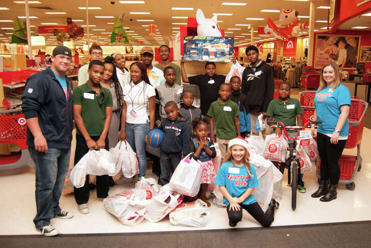 Kirstyn Jackson, front right in a Santa hat, poses with some of the foster children she took on a shopping spree in 2015.