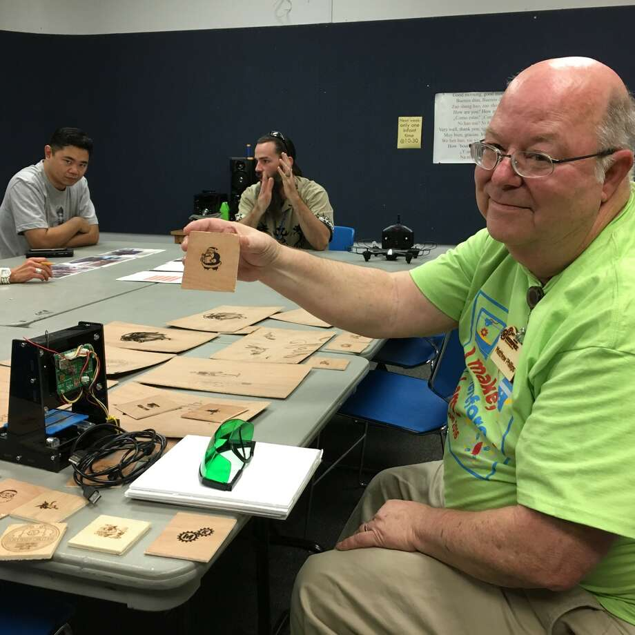 Matthew Phillips has belonged to the Katy MakerSpace group since September 2015. In the background are Eric Ng and Harold Krueger IV. Photo: Karen Zurawski