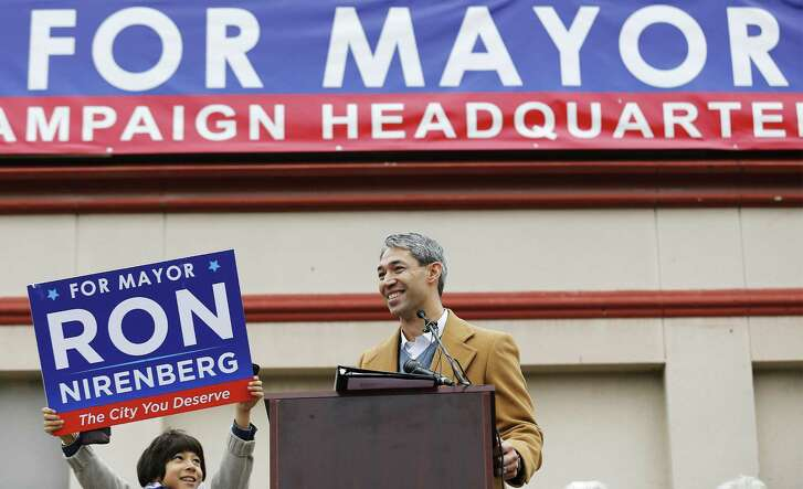 """District 8 Councilman Ron Nirenberg with his eight-year-old son Jonah holding up a campaign sign, announces his intention to run for city mayor to a large crowd gathered on Saturday, Dec. 10, 2016. Introduced by several VIPs and his wife, Erika, Nirenberg casted aside rumors and talk of his desire to be mayor. Nirenberg wasted little time in firing the first shot against Mayor Ivy Taylor as he brought up the issue of ethic violations against Taylor which Nirenberg and District 4 Councilman Rey Saldana were the only two opposing votes that effectively gave a pass to Taylor. Nirenberg touched on the city's population growth, economic opportunity, partnering with public school systems and on forging a transportation plan. """"I want more to say that I love it here (San Antonio) and I wouldn't live anywhere else,"""" Nirenberg said during his speech. (Kin Man Hui/San Antonio Express-News)"""