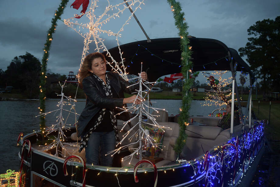 Betty Bales, of Huffman, tends to some last-minute decorations on the boat captained by her husband Thomas before the start of the Atascocita Yacht Club's 15th annual holiday boat parade at the staging area at Texas Adaptive Aquatics in Huffman on Dec. 11, 2016. (Photo by Jerry Baker/Freelance) Photo: Jerry Baker, Freelance / Freelance
