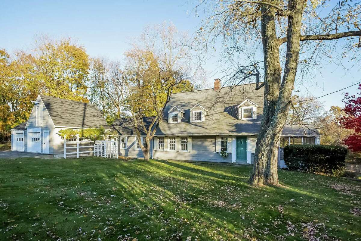 The gray farmhouse with buttercream yellow shutters and white trim at 60 Roseville Road in the Long Lots neighborhood, was purchased the day after Christmas in 1946, sight unseen, by famed author and illustrator Hardie Gramatky.