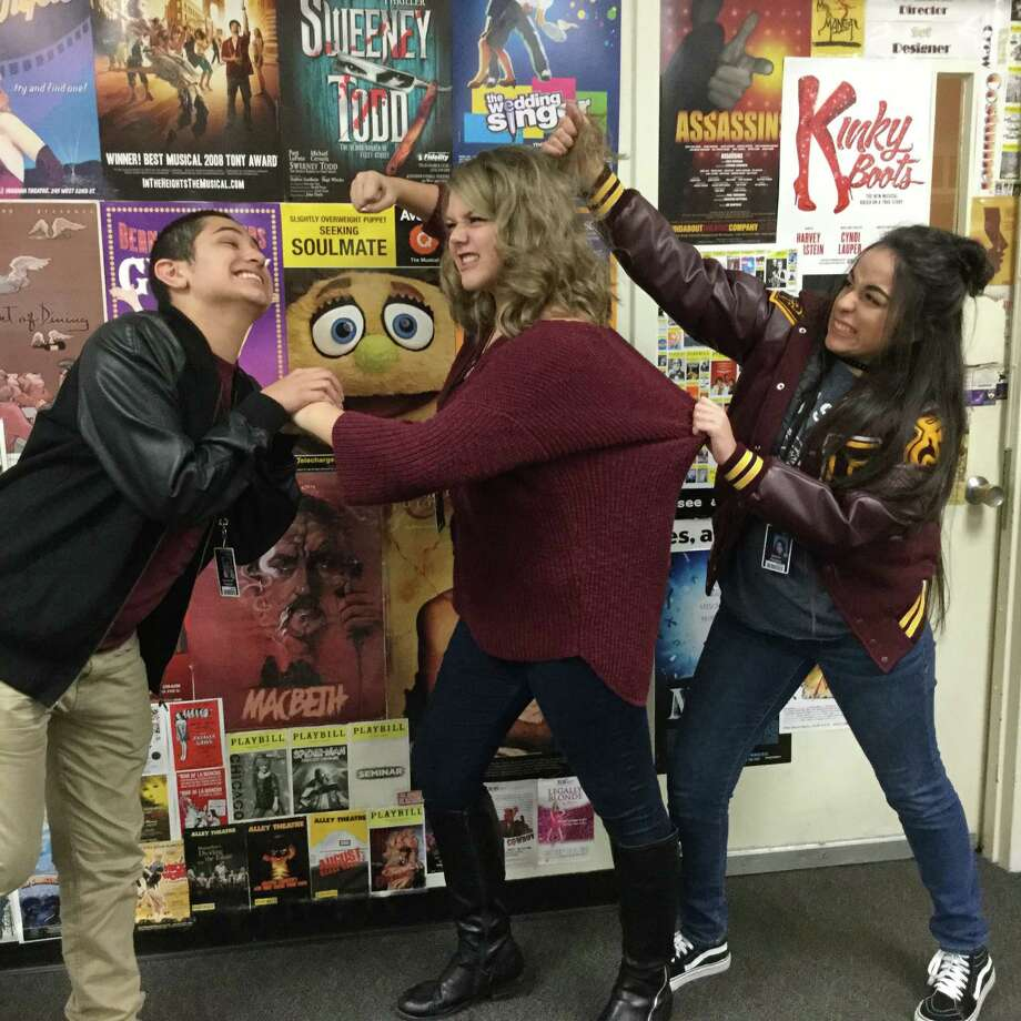 Deer Park High School students Nick Trevino, left, Abbey Holiman, and Melanie Pezino are ready for action at the Im-prov Comedy Shows scheduled for Dec. 15-16. The students are coached by head theater director Kelly Lawrence, who says that improvisation exercises help them become better actors.