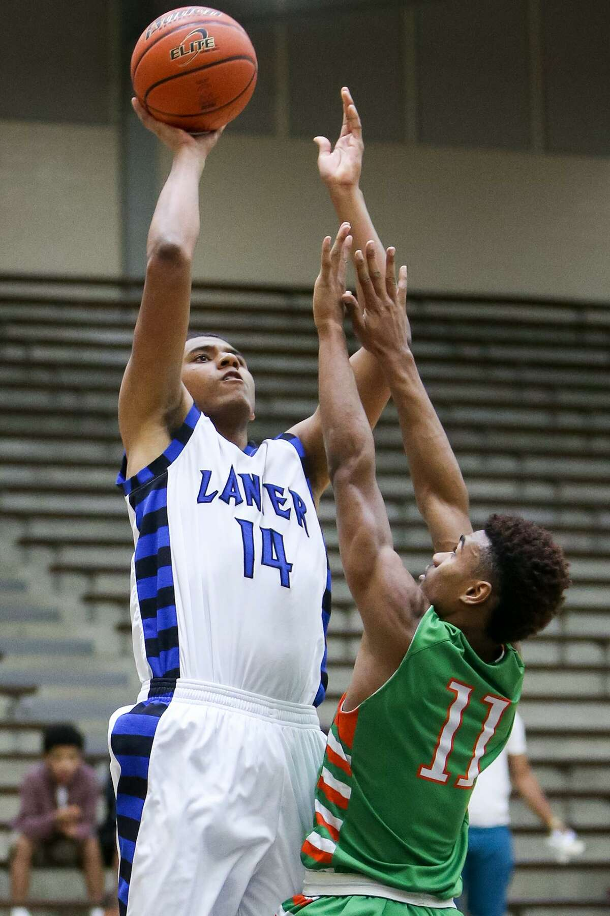 Lanier's Isaiah Vargas (left) shoots over Sam Houston's Juwan Anderson during the second half at the Alamo Convocation Center on Feb. 13, 2015.