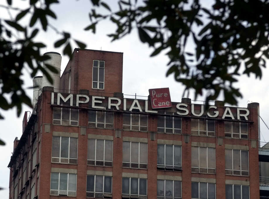 The Imperial Sugar refinery shut down in 2003; now a mixed-use development is being constructed in and around its old buildings, and the Sugar Land Heritage Foundation will open a new museum on the campus. Photo: PAT SULLIVAN, AP / AP