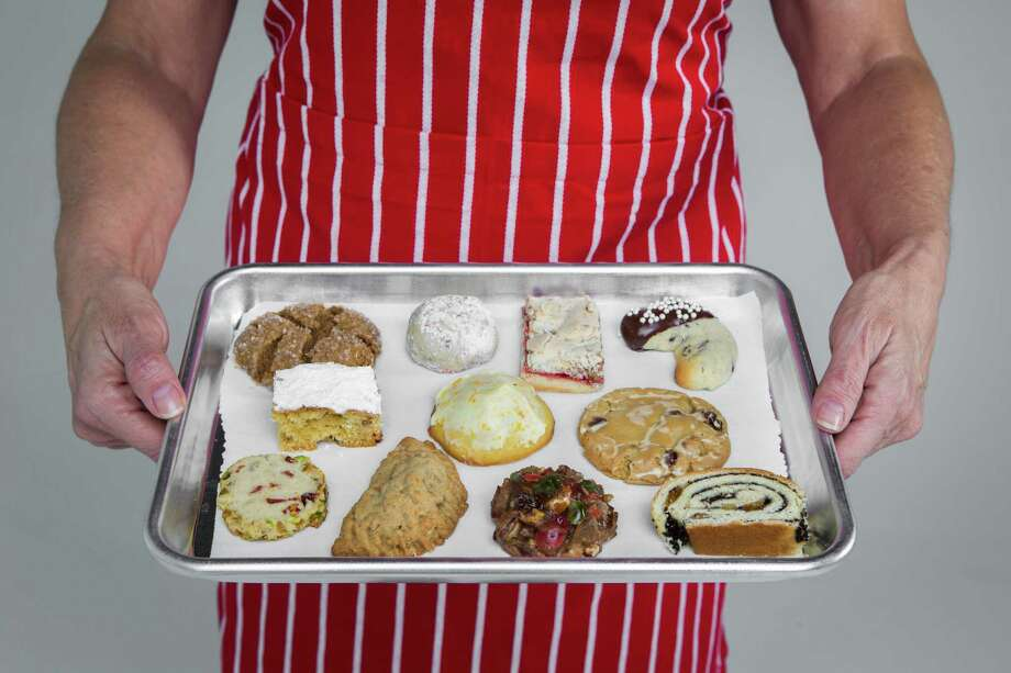 Top row, from left: Molasses Cookie; Peppermint Candy Cookie; Aunt Sophie's Special Christmas Cookie; and Chocolate Dipped Crescent. Middle row, from left:  Honey Date Bar; Orange Blossom Cookie; and TexKen Maple Brown Sugar Cookie. Front row, from left: Cardamom-scented Cranberry and Pistachio Shortbread Cookie; Marlowe's Filled Oatmeal Cookie; Dovie's Fruit Cake Cookie; and Poppy Seed Roll. Photo: Marie D. De Jesus, Staff / © 2016 Houston Chronicle