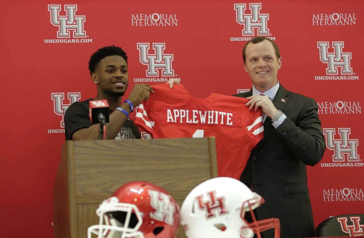 U of H quarterback Greg Ward left, introduces Major Applewhite as the new University of Houston football head coach at TDECU Stadium. Dec. 12,016 in Houston.