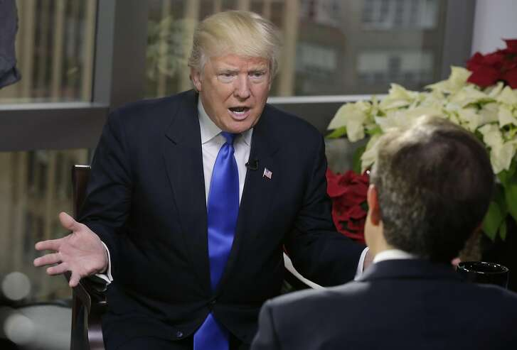 """President-elect Donald Trump is interviewed by Chris Wallace of """"Fox News Sunday"""" in Trump Tower, in New York,  Saturday, Dec. 10, 2016. (AP Photo/Richard Drew)"""