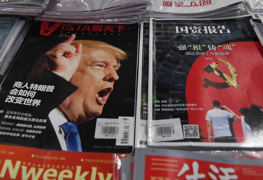 "A magazine seen in Beijing features the headline ""How will businessman Trump change the world?"" Photo: GREG BAKER, AFP/Getty Images"