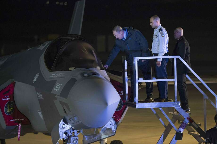 Israeli premier Benjamin Netanyahu looks over one of the F-35 stealth fighter jets his country just purchased. President-elect Donald Trump may cut the number of the planes the U.S. buys. Photo: JACK GUEZ, AFP/Getty Images