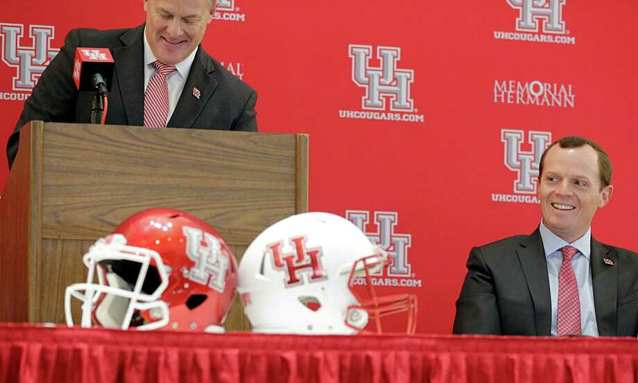 University of Houston Vice President of Athletics Hunter Yurachek left, speaks as Major Applewhite right, looks on during a press conference announcing Applewhite as the next University of Houston football head coach at TDECU Stadium Dec. 12, 2016, in Houston. Photo: James Nielsen, Houston Chronicle / © 2016  Houston Chronicle