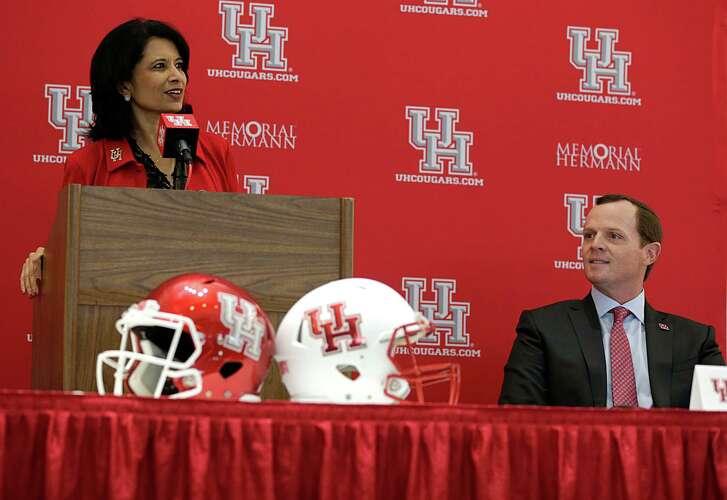 University of Houston President Renu Khator left, speaks as Major Applewhite right, looks on during a press conference announcing Applewhite as the next University of Houston football head coach at TDECU Stadium Dec. 12, 2016, in Houston.