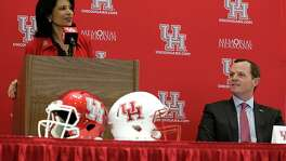 University of Houston President Renu Khator left, speaks as Major Applewhite right, looks on during a press conference announcing Applewhite as the next University of Houston football head coach at TDECU Stadium Dec. 12, 2016, in Houston.