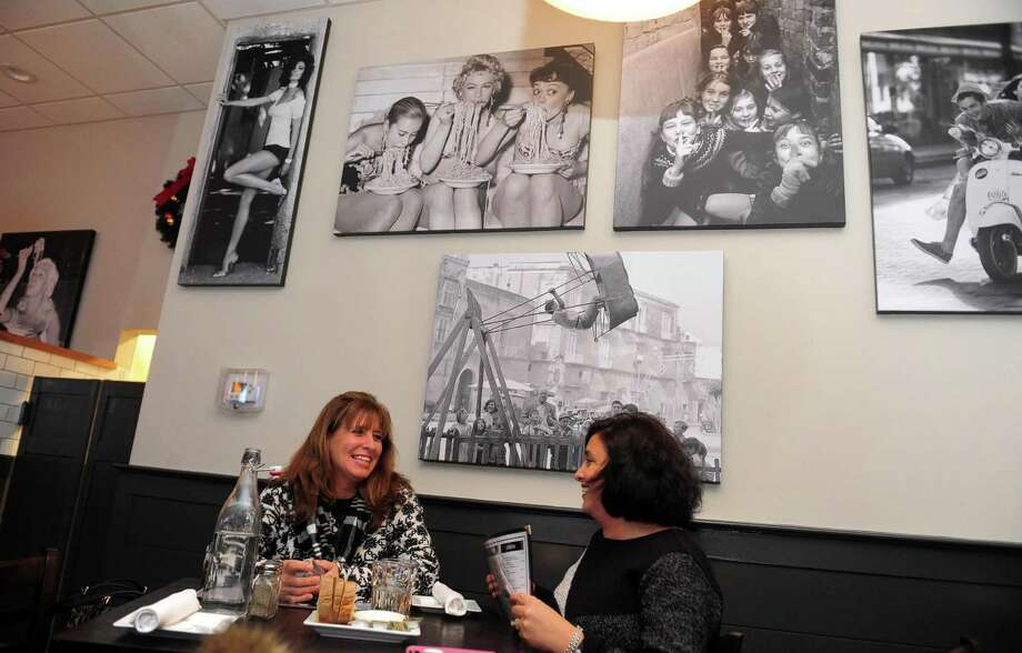 Customers Cindy Estwan, of Derby, at right, and her friend Maria DiSorbo, of Orange, dine at Lulu Pazzo Italiano, a new restaurant on Main Street in Ansonia, Conn. on Friday Dec. 9, 2016. Photo: Christian Abraham / Hearst Connecticut Media / Connecticut Post
