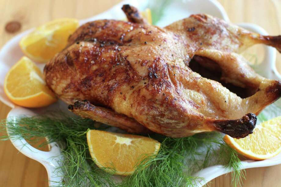 Roasting a duck is no more complicated than roasting a turkey, and this recipe also has a French-style sauce. Photo: Matthew Mead, FRE / FR170582 AP