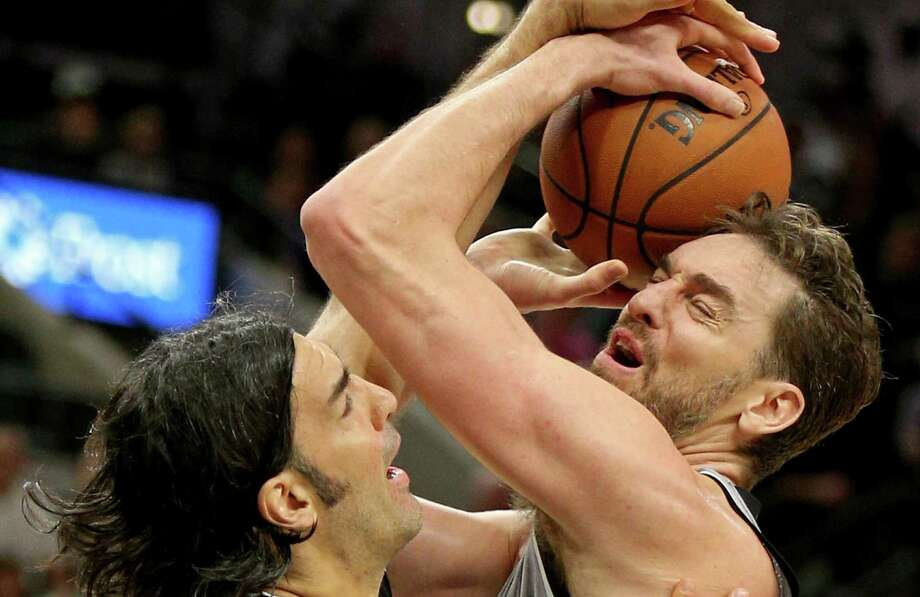 Spurs' Pau Gasol is fouled by Brooklyn Nets' Luis Scola during second half action on Dec. 10, 2016 at the AT&T Center. Photo: Edward A. Ornelas /San Antonio Express-News / © 2016 San Antonio Express-News