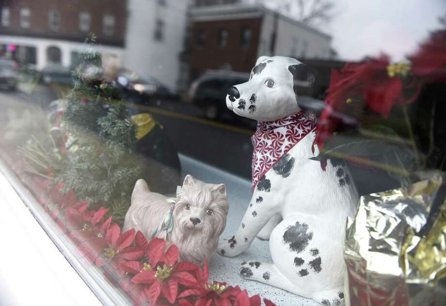 Festive holiday dog statues sit in the window of Professional Dog Grooming in the Byram section of Greenwich, Conn. Monday, Dec. 12, 2016. Professional Dog Grooming won the Greenwich Chamber of Commerce's holiday window decorating award for Byram. Photo: Tyler Sizemore / Hearst Connecticut Media / Greenwich Time
