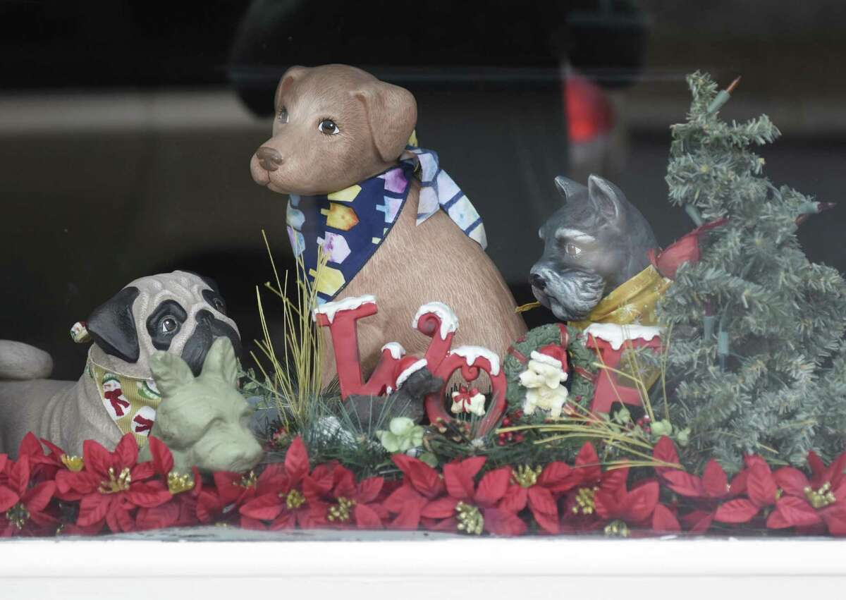 Festive holiday dog statues sit in the window of Professional Dog Grooming in the Byram section of Greenwich, Conn. Monday, Dec. 12, 2016. Professional Dog Grooming won the Greenwich Chamber of Commerce's holiday window decorating award for Byram.