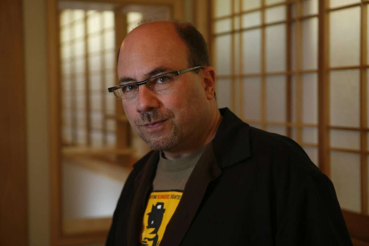 Craig Newmark, founder of Craigslist, and his girlfriend, Eileen Whelpley, show the newly completed yoga room built in Newmark's basement on Friday, Sept. 4, 2009 in San Francisco, Calif.