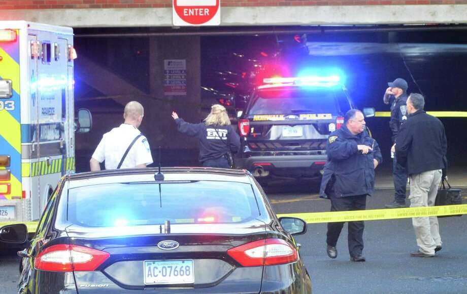 Norwalk police, detectives and paramedics respond to the scene of an apparent suicide at the Norwalk Hospital parking garage on Stevens St. in Norwalk Conn. on Monday December 12, 2016 Photo: Alex Von Kleydorff / Hearst Connecticut Media / Connecticut Post