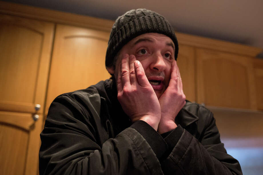 Keith Johnson rubs his face as we talk about his work as a peer support specialist and how his journey through depression informs his work, at his home in Kent on Dec. 1, 2016. Photo: GRANT HINDSLEY, SEATTLEPI.COM / SEATTLEPI.COM