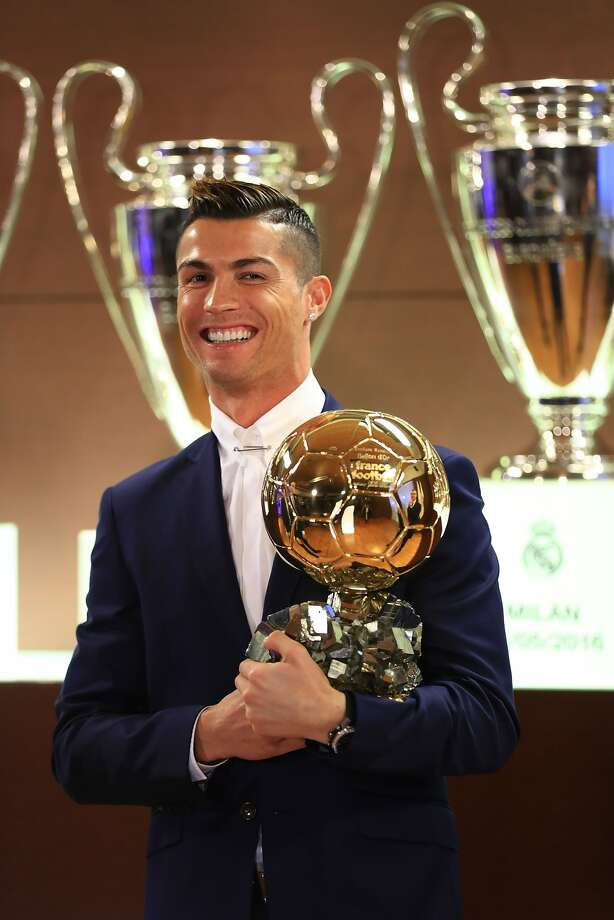 """Handout photo released on December 12, 2016 by L'Equipe shows Portugese player Cristiano Ronaldo posing with the Ballon d'Or France Football trophy in Madrid. Cristiano Ronaldo was named winner of the Ballon d'Or on December 12, 2016 for the fourth time, organisers France Football said, capping a terrific year for the Real Madrid star. / AFP PHOTO / L'EQUIPE / FRANCK SEGUIN / RESTRICTED TO EDITORIAL USE - MANDATORY CREDIT """"AFP PHOTO / FRANCK SEGUIN / LEQUIPE"""" - NO MARKETING NO ADVERTISING CAMPAIGNS - DISTRIBUTED AS A SERVICE TO CLIENTS  FRANCK SEGUIN/AFP/Getty Images Photo: FRANCK SEGUIN, AFP/Getty Images"""