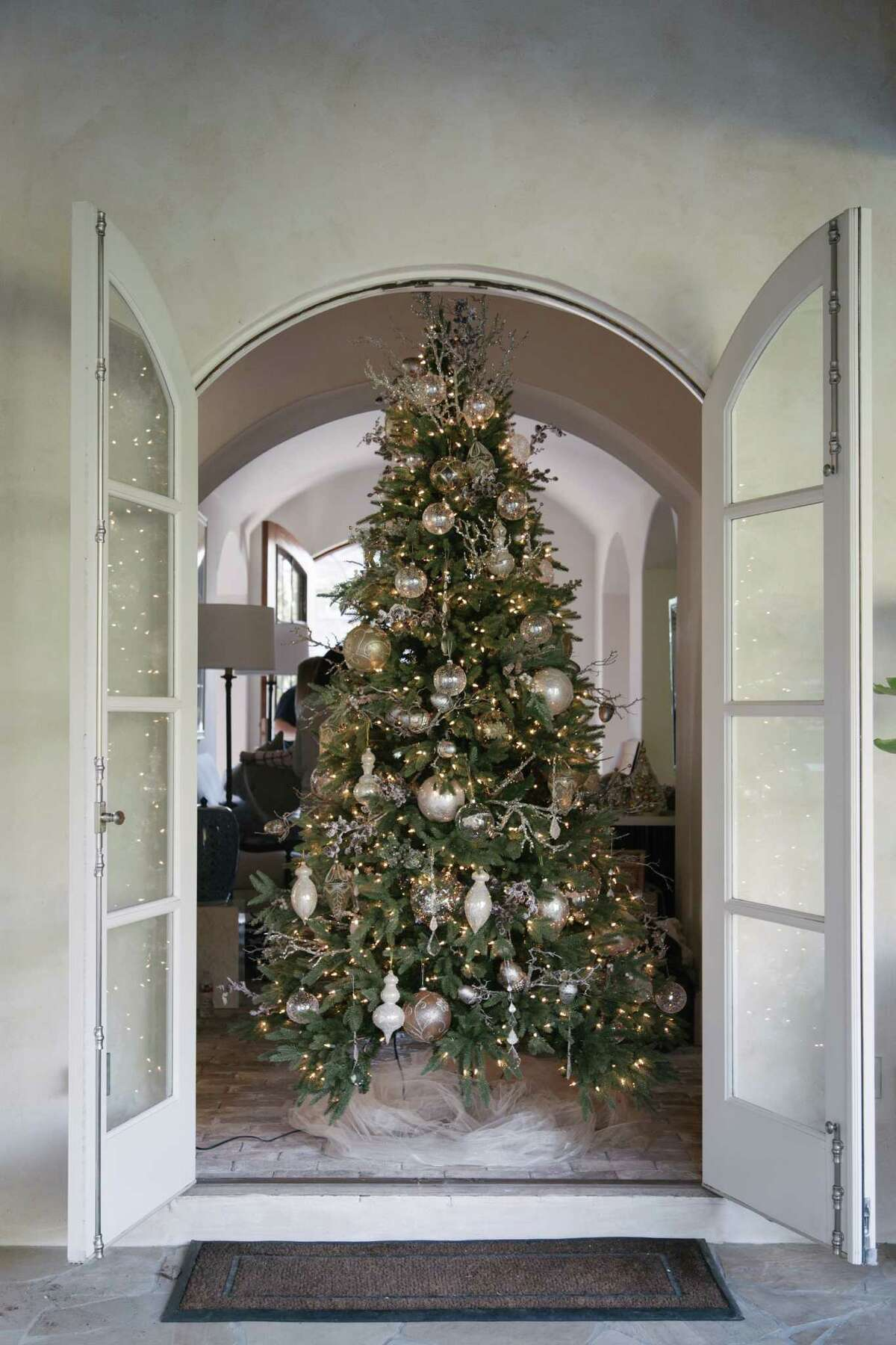 A nine-foot tree welcomes guests to the D'Antoni home.