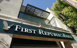 A First Republic Bank in Palo Alto, Calif. is shown Wednesday, Oct. 21, 2009. Bank of America Corp. has agreed to sell First Republic Bank, a private bank it inherited from Merrill Lynch & Co., to a group of investors for more than $1 billion, according to a report Wednesday by The Wall Street Journal. (AP Photo/Paul Sakuma)